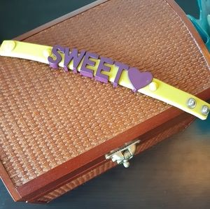 "BCBGeneration Yellow ""Sweet💜"" Rubber Bracelet"